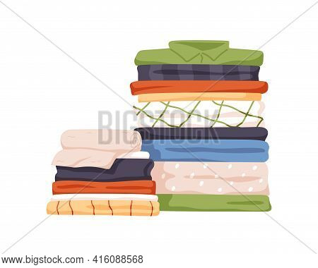 Stack Of Neat And Clean Clothes. Pile Of Neatly Folded Shirts, Tshirts, Jeans, Trousers, Pants And B