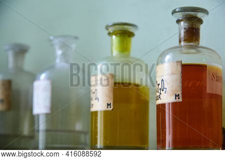 Old Chemical Laboratory. Photo Of An Old Laboratory With A Lot Of Bottles And Dirt