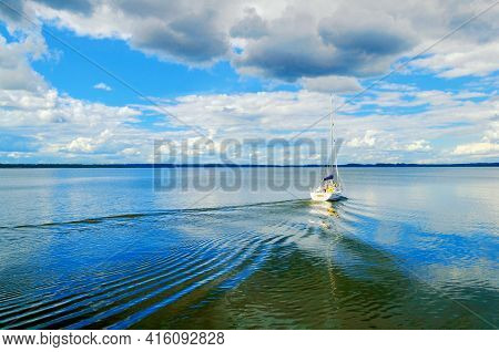 Summer vacation background, summer vacation time. Blue lake, boat on a summer lake. Vacation concept, summer vacation landscape,summer vacation time, summer vacation scene, summer vacation landscape