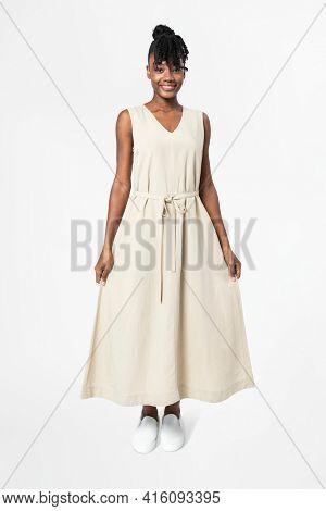 Woman in sleeveless dress casual wear apparel full body