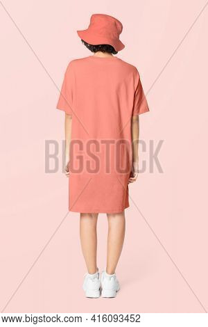 Woman in peach t-shirt dress and bucket hat casual wear apparel