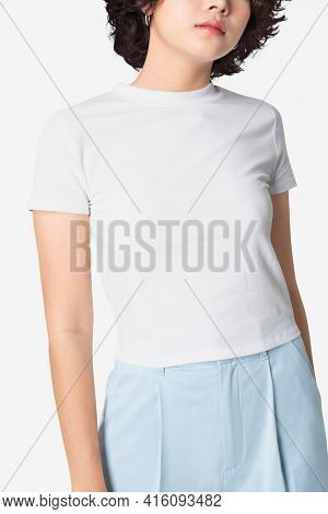 Beautiful woman in basic white t-shirt with design space