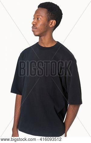Man in simple black tee studio portrait