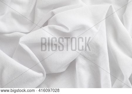 White Texture Background. Crumpled Textile. Close Up.