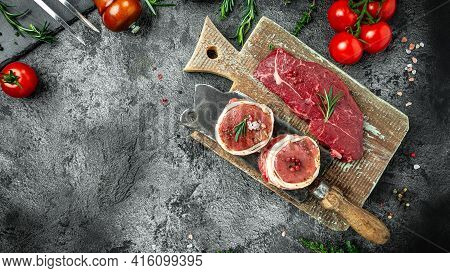 Set Raw Beef Steak On A Dark Table. Beef Rump Steak, Tenderloin Fillet Mignon For Grilling. Long Ban