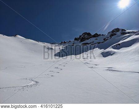Ski Touring Track. Freeride In Powder Snow Above Elm. Big Mountains In Switzerland. Ski Touring Moun