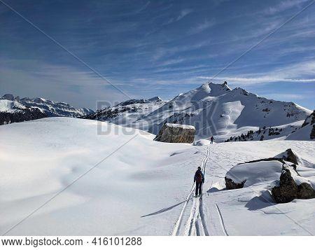 Freerider Downhill Mountain Powder Snow. Ski Tour In The Swiss Mountains. Young Man Enjoys Life. Ski