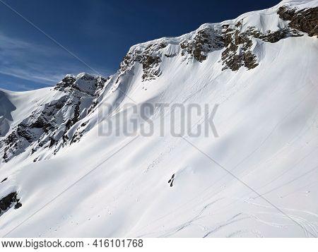Big Snow Drift In The European Mountains. Photo Near The Schwarzstockli In Glarus. Winter Landscape,