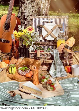 Vintage Picnic Basket, Hamper With Baguette And Lemonade Outdoors On A Grass With Cheese, Mozzarella
