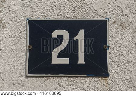 Weathered Grunge Square Metal Enamelled Plate Of Number Of Street Address With Number 21