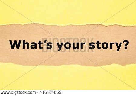 Printed Question What Is Your Story Appearing Behind Torn Yellow Paper.
