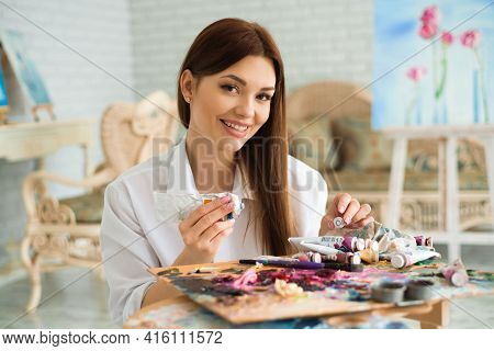 The Artist, Paint Palette Brushes, Different Colors. The Girl Is Drawing. The Artists Tools For Real