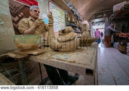 Meybod, Iran - 14.04.2019: Potter Working With Clay In His Pottery Shop In Iran. Persia.