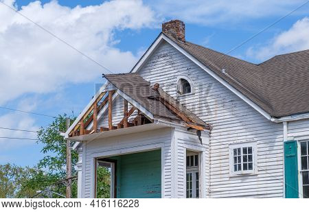 New Orleans, La - March 22: Worker's Head Pokes Through The Roof As He's Demolishing Section Of Hous