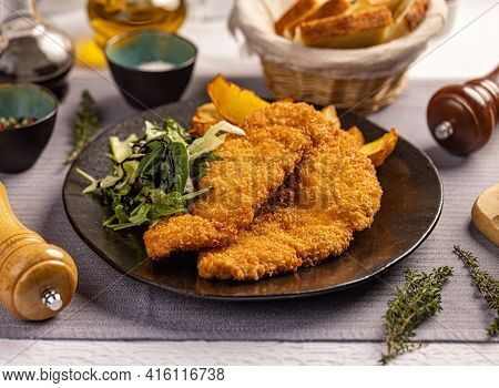 Delicious Crispy Fried Breaded Chicken Breast Strips On Restaurant Table