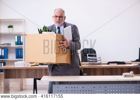 Old male employee being fired from his work