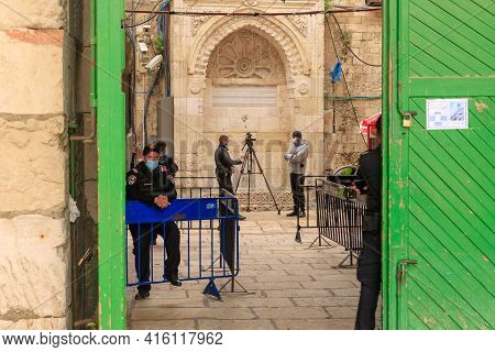 Jerusalem, Israel, March 3, 2021 : Reporters Filming Behind The Iron Gates - Bab Al-hadid Leading To
