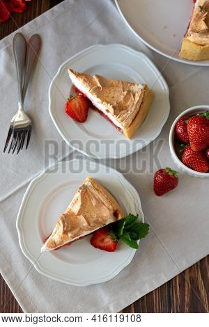 Slice Of Delicious Strawberry Tart With Meringue On Wooden Background. Summer Food. Top View