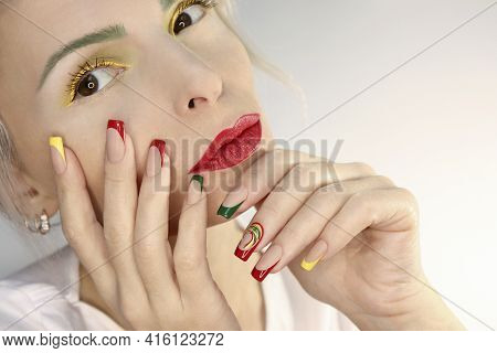 Model With Multicolored Makeup And French Manicure.