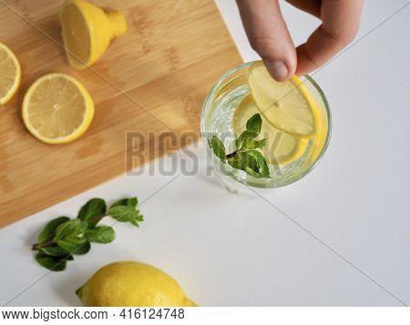 Woman Preparing Lemon Water. Detox Water With Mint And Lemon. Refreshing Summer Drink. Wellness, Die