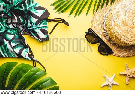 Straw Beach Hat And Sun Glasses Top View On Yellow Background, Summer Flat Lay