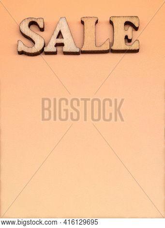 Discount Sale. Large Letters Sale, Action. Wooden Letters Discount On Orange Background.