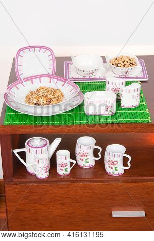 Crockery Set For The Home; Photo On Wooden Background.