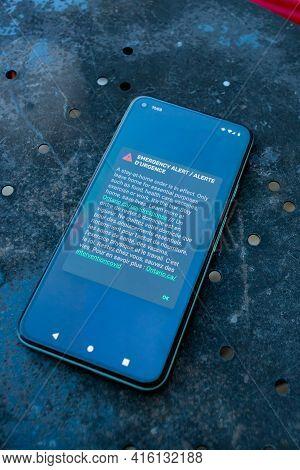 Ottawa, Ontario, Canada - April 8, 2021: A Smartphone Screen Displays An Emergency Alert Notifying O
