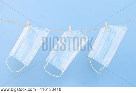 Washable Protective Face Masks, Used For Virus Protection, Hanging On Wash Line With Clothespins