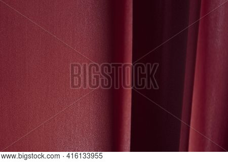 Abstract Background Of Luxury Fabric Or Liquid Silk Texture Of Waves Or Wavy Folds. Red Cloth. Backg
