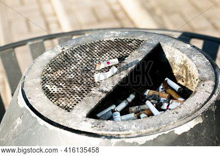Dnepropetrovsk, Ukraine - 03.21.2021: Urn For Smoking With Cigarette Butts. Cigarette Butts In Ashtr
