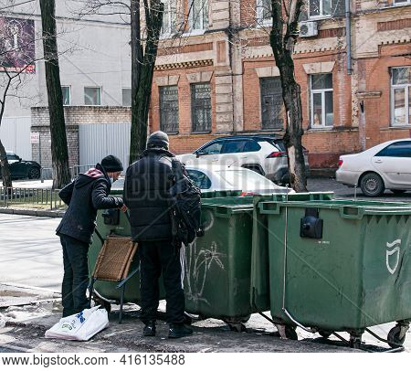 Dnepropetrovsk, Ukraine - 03.21.2021: A Man Drinks Alcohol From A Bottle On The Street. Two Homeless