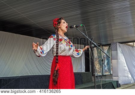Dnipro, Ukraine - August 21, 2020: Woman In Traditional Ukrainian Costume Sing Emotionally And Sensu