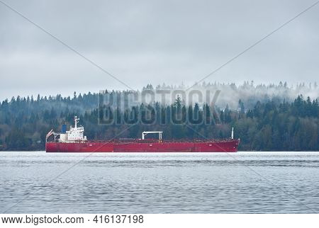 Oil Tanker And Mist. An Oil Tanker Anchored In A Misty Burrard Inlet. Vancouver, British Columbia, C
