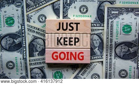 Just Keep Going Symbol. Wooden Blocks With Words 'just Keep Going'. Beautiful Background From Dollar
