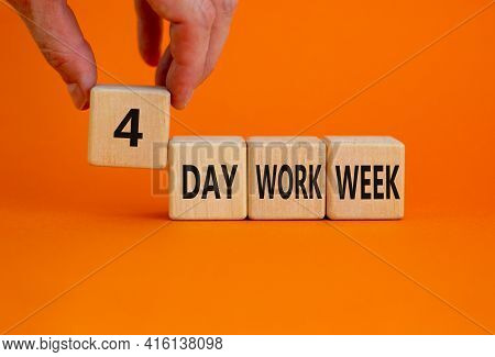 4 Day Work Week Symbol. Businessman Holds The Cube With Words '4 Day Work Week'. Beautiful Orange Ba
