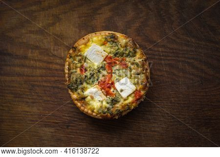 Broccoli Quiche And Salad Leaves On Wooden Chopping Board.