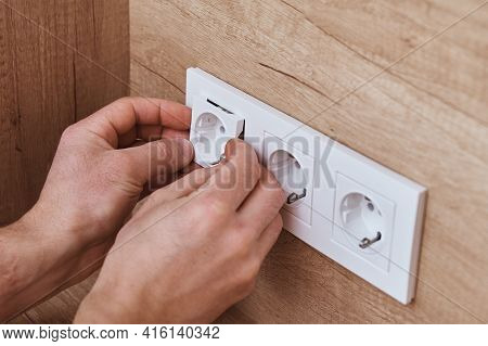 Electrician Hands Mounting Socket In The Wall. Socket Installation