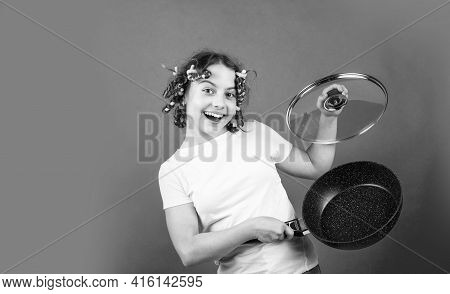 Fashion Home Shot. Pin-up Style. Girl Holding Frying Pan. Little Homemaker Holding Pan With Ready Me
