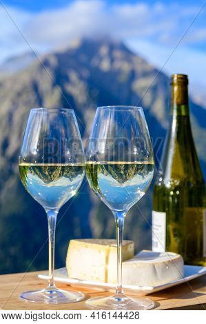 Tasty Cheese And Wine From Savoy Region In France,  Tomme And Reblochon De Savoie Cheeses And Glass