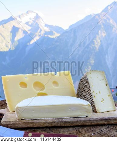 Cheese Collection, French Emmental, Tomme And Reblochon De Savoie Cheeses Served Outdoor In Savoy Re