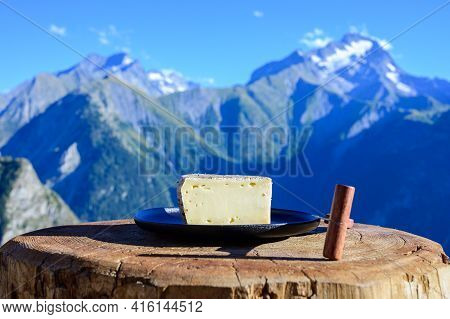 Cheese Collection, French Tomme De Savoie Or Tome Des Bauges Cheese Served Outdoor With Alpine Mount