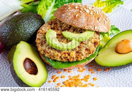 Tasty Vegetarian Healthy Food, Homemade Burgers Made From Orange Lentils Legumes With Green Lettuce