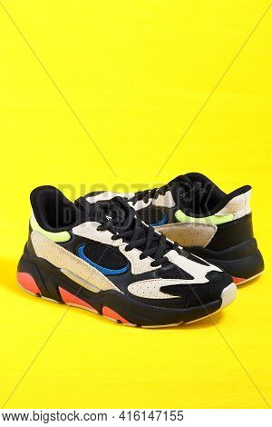 Womens Sneakers. Sports Womens Shoes. Isolated, Yellow Fog, Vertical Image With A Place For Inscript