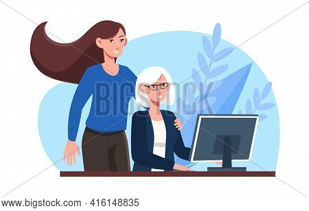 Office Workers At Workplace. Young And Mature Businesswomen In The Office. Mature Gray-haired Woman