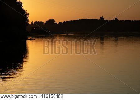 Sunset Reflections In The Water Of The Po River, Italy