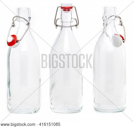 Several Glass Bottles With 500 Ml Soda Type Closures. Without Label And Isolated On White Background