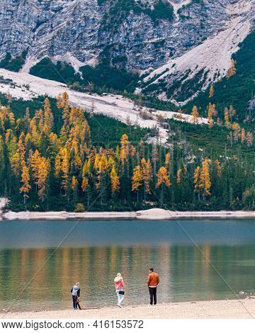 Lago Di Braise, Italy, October 20 2019: Family At The Lago Di Braise In The Italian Alps In Autumn.