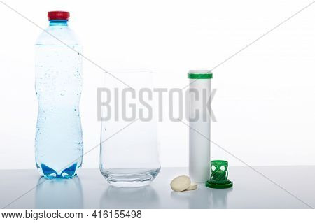 Drinking Water Bottle, Glass And Vitamins. Glass With Water And Pills. White Background.
