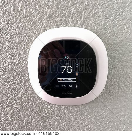 An Ecobee Smart Thermostat In A Home.